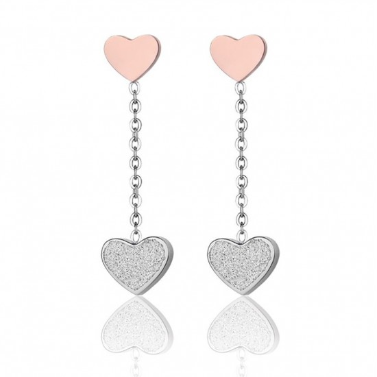 Earrings with the heart symbol of love in pink and white glitter from stainless steel OK1049