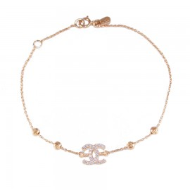 Gold bracelet K14 with white zircons and chanel designhanel 142135