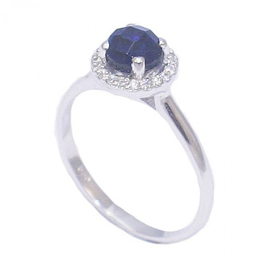 Silver solitaire ring with rosette in blue and white zircons  2017