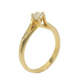 Solitaire ring in gold K14 with flame design and zircon in white 27525